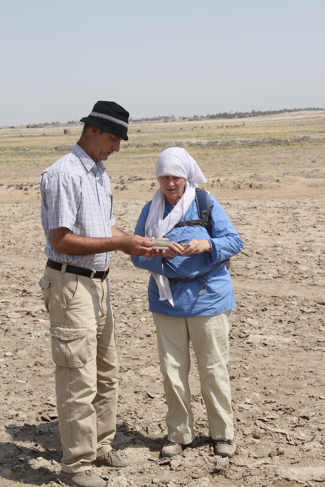 Abdul-Amir Hamdani '15 and Dr. Elizabeth Stone at Tell Sakheriyah, examining ceramics to determine the date of the site. Tell Sakheriyah was occupied at a time when many other sites were abandoned, likely due to shifts in the river regimes (photo by Paul Zimansky, 2011).