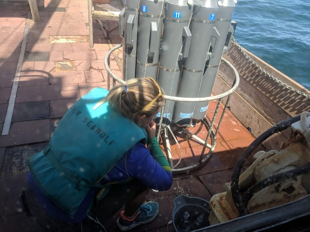 Julia Stepanuk performs research aboard the R/V/ Seawolf.