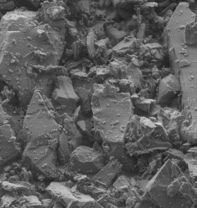 Scanning electron microscopy image of the micro-structure of albite prior to the rapid compression experiments. The image spans about 0.036 mm. Credit: Stony Brook University, Lars Ehm