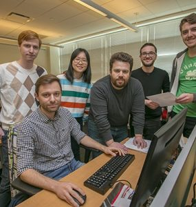 Professor Nikiforakis and his team of students collaborate in the PragSec lab in the New Computer Science Building.