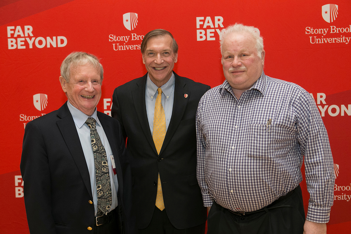 President Stanley (center) with two of this year's 50-year honorees, David Hicks and Hal Metcalf.
