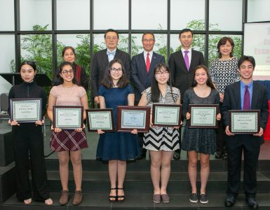 Front row, third from left: First-Place Winner Keika Berger; back row, left to right: Sachiko Murata, Chief Judge, JCSB Essay Competition; Iwao Ojima, JCSB President; Kevin Ogawa, President & COO, Canon USA; Masaru Sato, Deputy Consul General and Director of Japan Information Center, Consulate General of Japan in New York; and Eriko Sato, Chair, JCSB Executive Committee