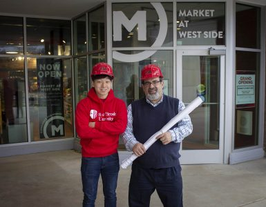 FSA's Facilities Director Jeff Moss and mentee William Zhu '21, pictured outside the Market at West Side, 2019 Long Island Business News Real Estate, Architecture and Engineering Award for Top Education Renovation winner