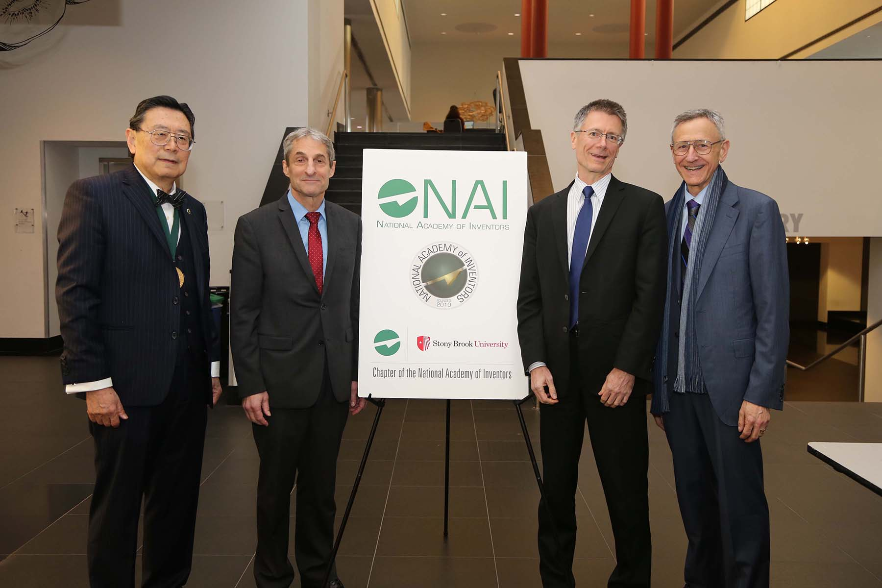 Left to right: Drs. Iwao Ojima, President NAI-SB; Richard Reeder, Vice President for Research; Peter Donnelly, Executive Director, NAI-SBU; and Kenneth Kaushansky, Dean, School of Medicine.