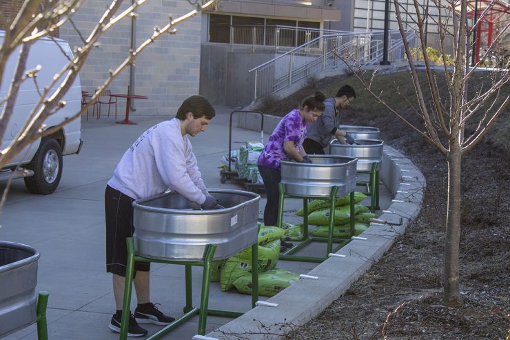 Sustainability Studies students collaborated with FSA to build raised beds at the East Side Dining patio.