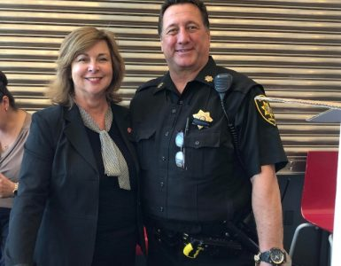 Kathleen Valerio( left) with Officer Ron Saager
