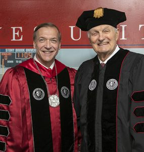 President stanley and alan alda