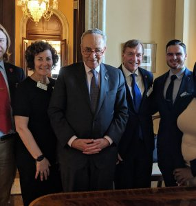 (L-R): President of USG Justas Klimavicius; Chief Deputy to the President Judy Greiman; U.S. Senate Minority Leader Chuck Schumer; President Samuel L. Stanley, Jr.; President of GSO James Vassallo; and 2018 Wolfie Tank Winner Yark Beyan.