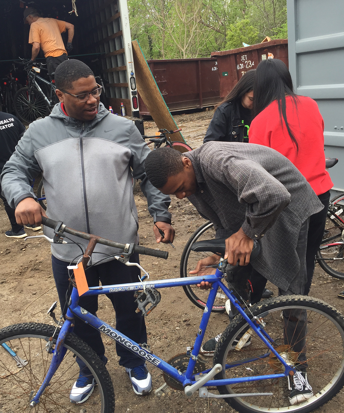 Student volunteers working together to load the bicycles.