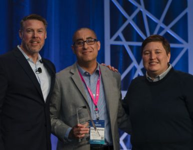 Stefan Hyman (center) at the award ceremony with Paul McConville, Senior Vice President of Hobsons, and Amy Reitz, General Manager, Intersect