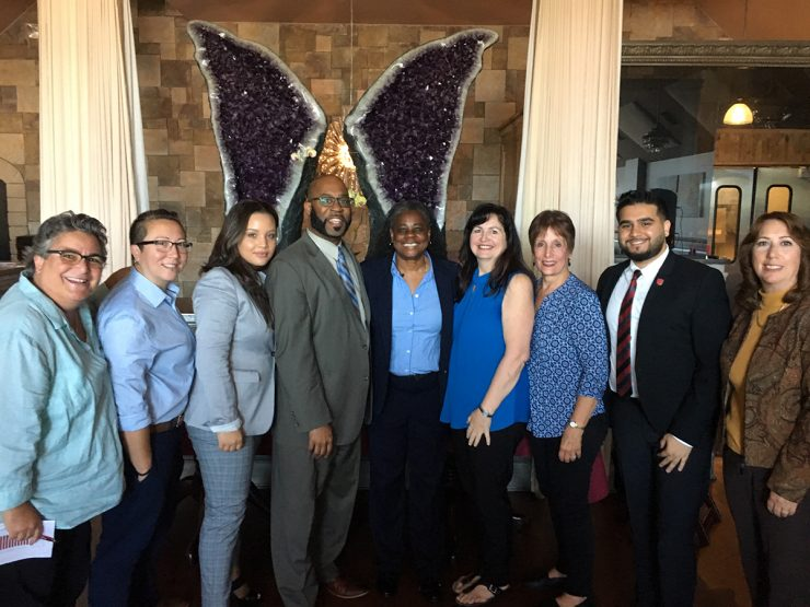 Left to right: Margot Garant, Mayor of Port Jefferson Village, Chris Tanaka, Assistant Director for SBU  LGBTQ Services, Yamilex Taveras, undergraduate student and president of the Latin American Student Organization (LASO), Dr. Jarvis Watson, SBU Chief Diversity Officer, Dr. Robbye Kinkade, Clinical Professor in the School of Health Technology and Management, Mary Joy Pipe, President of the Greater Port Jefferson Chamber of Commerce, Barbara Ransome, Director of Operations for the Grater Port Jefferson Chamber of Commerce, Shaheer Khan, President of the Undergraduate Student Government (USG) and Joan Dickinson, SBU Community Relations Director.