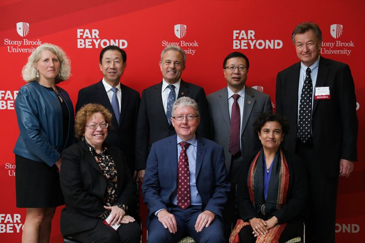 The recently appointed Distinguished Professors with Interim President Bernstein.
