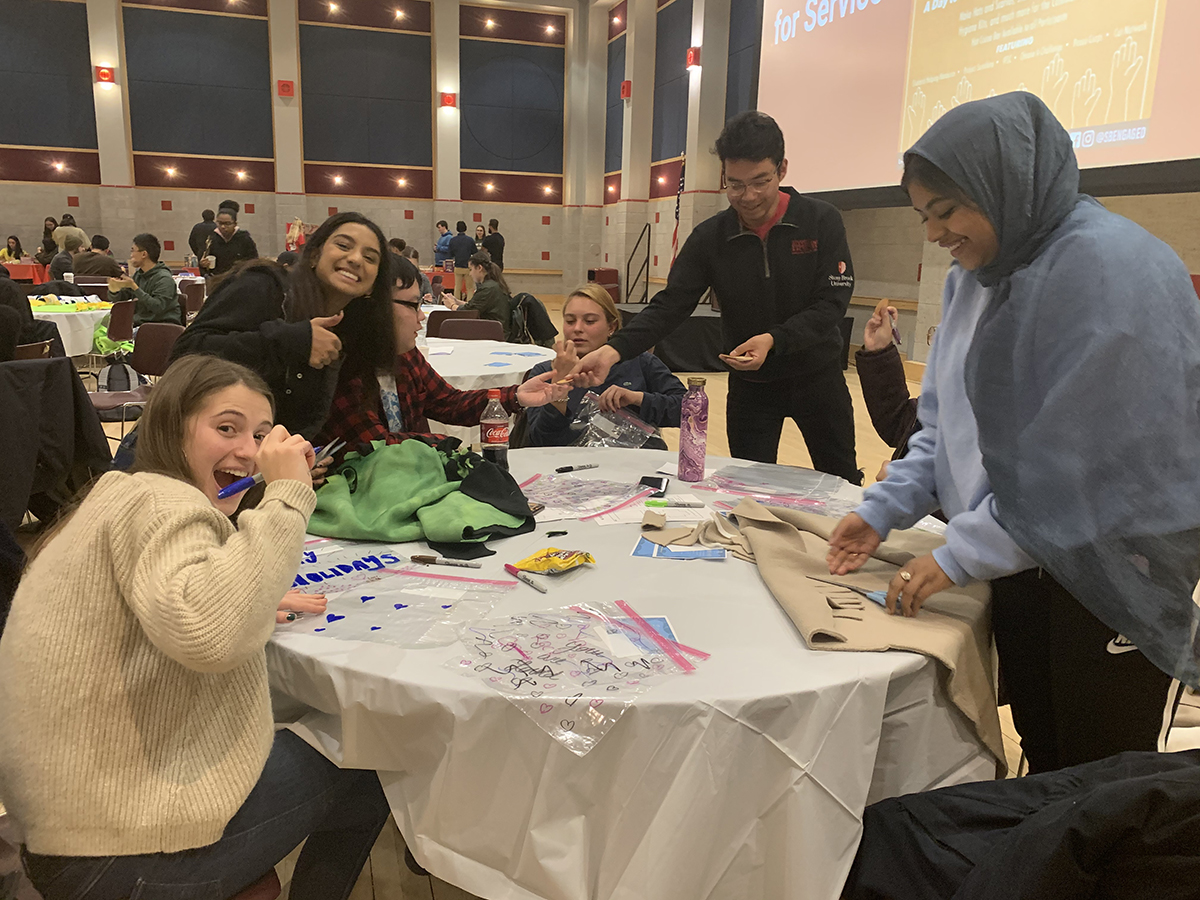 The event hosted hands-on service learning activities, where students created hygiene kits, snack packs, dog blankets, and hats and scarves for those in need.