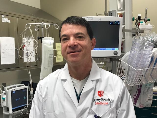 Dr. Adam Singer