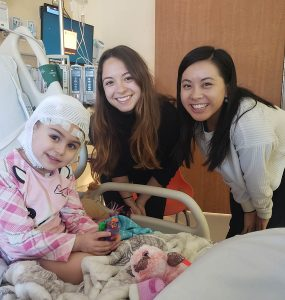 Four-year-old patient Gianna Ciaffone with dancers Haley Heckethorn and Tiare Keeno