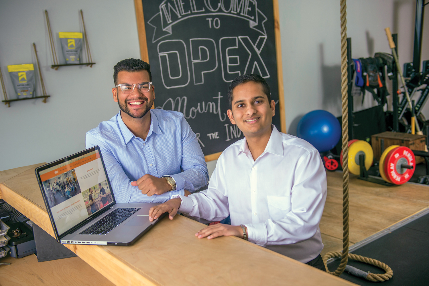 Ariel Rodriguez '19 (left) and Yash Jain '18 designed the website for one of their clients, OPEX Fitness in Mount Sinai.