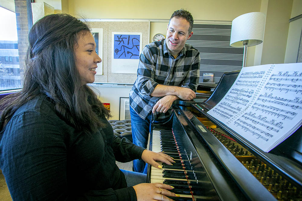 Michael Hershkowitz, Executive Director of Community Music Programs, with voice student Mirette Nunez '20