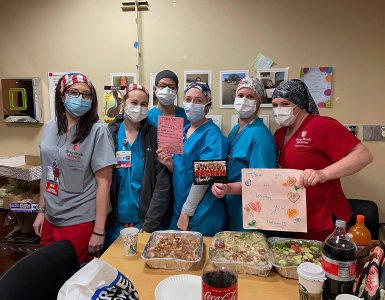 Stony Brook University Hospital staff with the food and thank you cards given to them by the Sachem 11s Cheer Team.