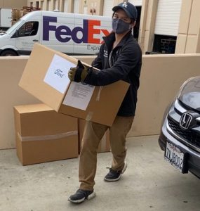 Kevin Tsai '19 carries donations of PPE.