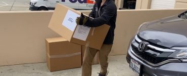 Kevin Tsai'19 carries donations of PPE.