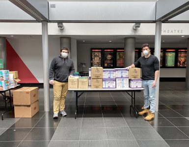 Pano Sourlis (left) and Vincent DeStefano (right) with donations from local school districts they delivered to the Wang Center for Stony Brook University Hospital's frontline workers.