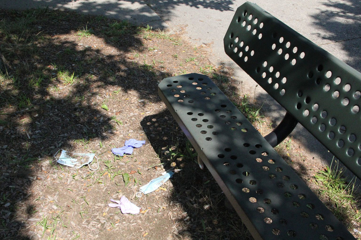 With face masks and other personal protective equipment ending up on sidewalks and other outdoor spaces, a seasonal campaign goes beyond encouraging citizens to break the single-use plastic habit by using reusable bags and bottles at the beach and local park. #DontTrashLISound reminds folks to discard #PPElitter in a secure trash can. Credit: Judy Benson / Connecticut Sea Grant