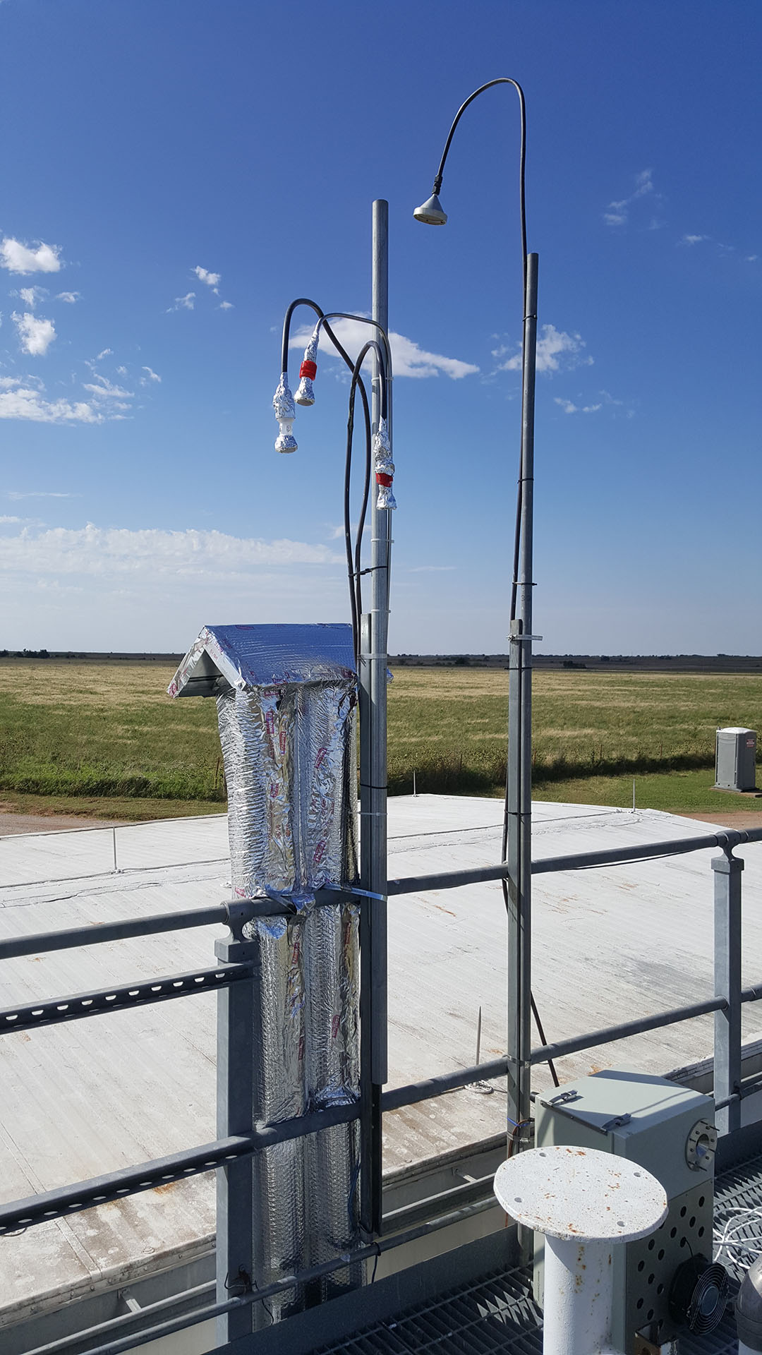 An aerosol sampling stack and inlet tubes at the DOE's Atmospheric Radiation Measurement Program Site in Oklahoma for studying ice formation from aerosol particles.