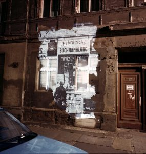 "Almstadtstrasse 43: Slide projection of former Hebrew bookstore, 1930, Berlin,1992, 33""X40"" chromogenic photograph and on-location installation, Shimon Attie, courtesy of Jack Shainman Gallery, New York"