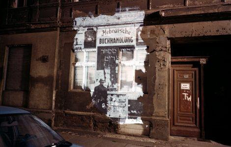 "Almstadtstrasse 43: Slide projection of former Hebrewbookstore, 1930, Berlin,1992, 33""X40"" chromogenic photograph and on-locationinstallation, Shimon Attie, courtesy of Jack Shainman Gallery, New York"