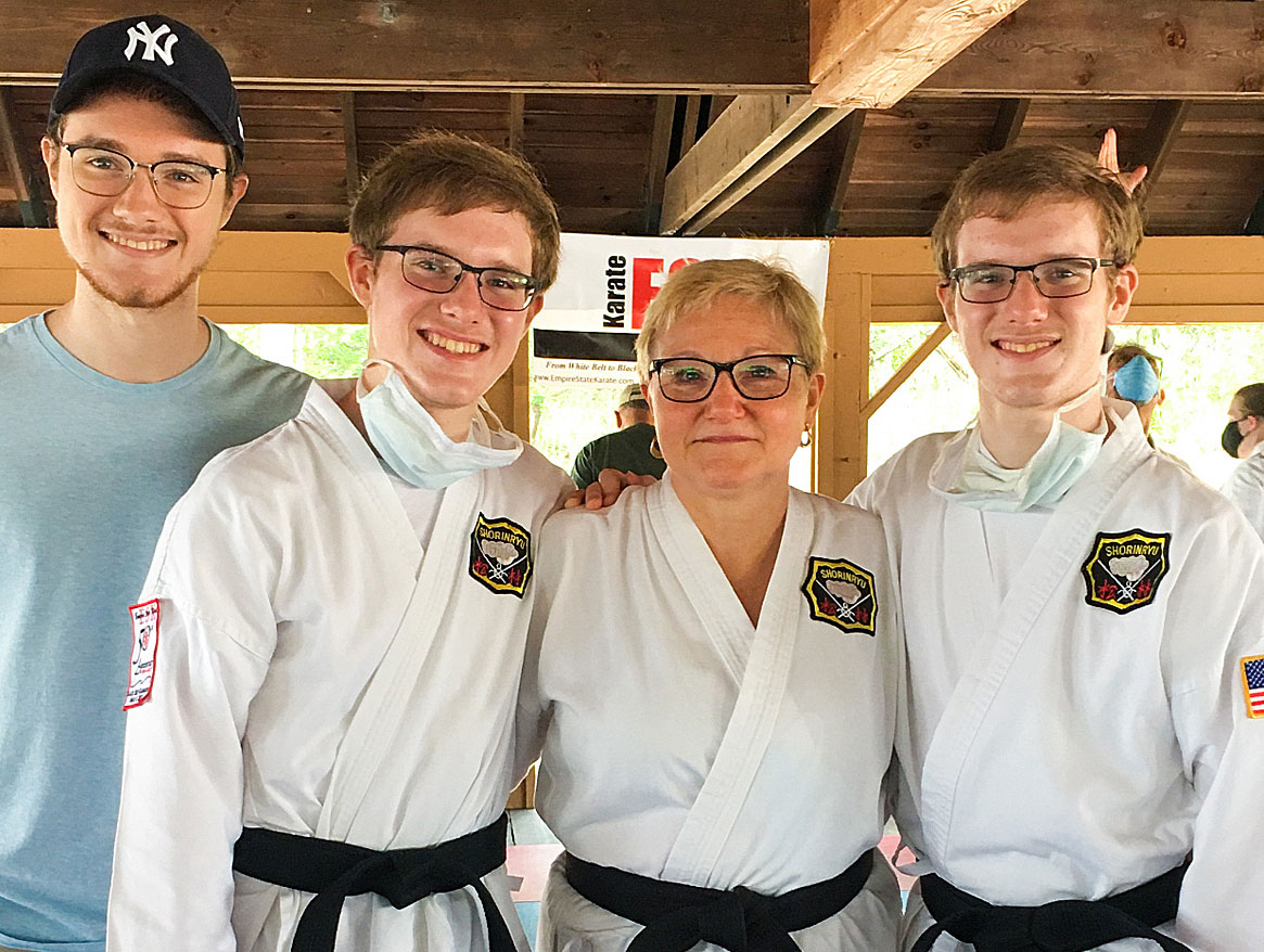 "Dr. Donlelan with her sons. ""One of the first things I teach my karate students is situational awareness. Being aware of what's going on around you. This is also what's so important in epidemiology. When you see a threat coming, you have to be prepared."""