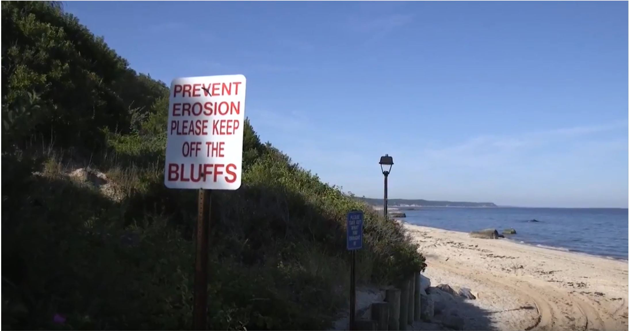 In an effort to help prevent erosion, signage encourages beachgoers to keep off coastal bluffs. New research supported by NY Sea Grant will provide information that will allow for improved prediction of bluff erosion that informs planning by coastal communities. Image credit: Cornell Cooperative Extension Marine Program