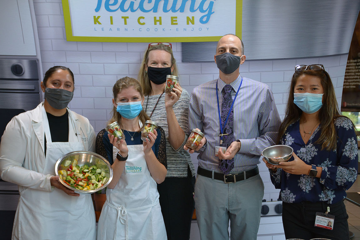 Students and staff learn how they can eat healthier and more sustainably with a plant-based diet with fun options such as shaker salads in ball jars.