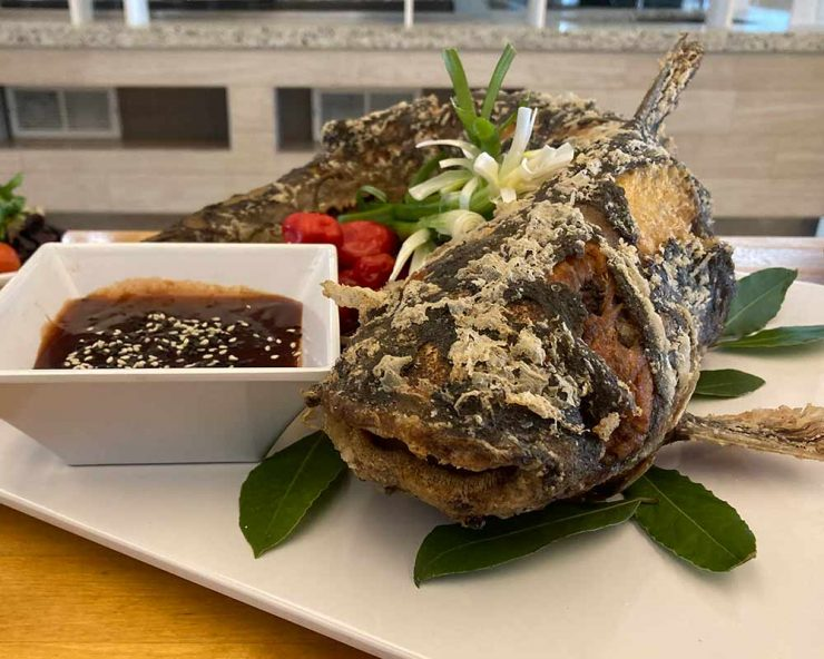 Crispy whole fish stuffed with ginger
