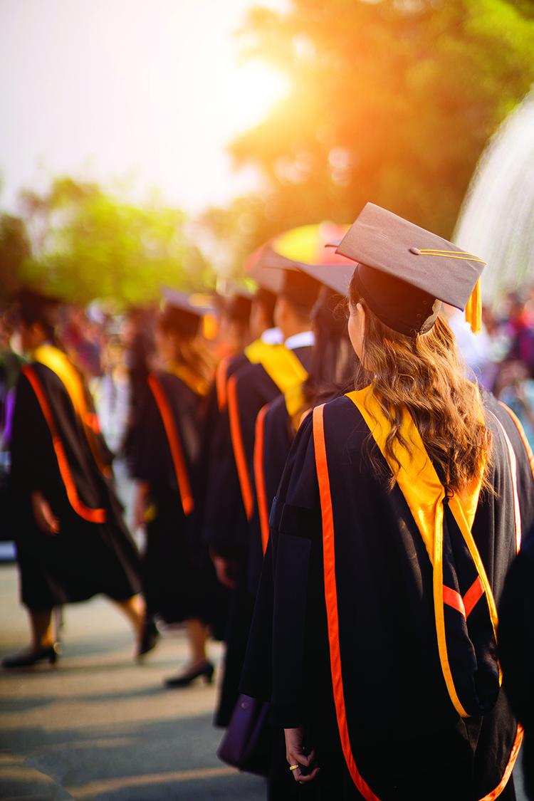 Rear view of the university graduates