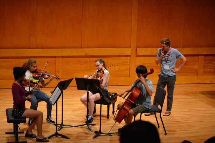 Students engaged in music learning with the Music department summer program.