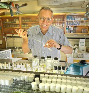 F. William Studier in 2004; in the 1980s, Studier and a team of collaborators deciphered key details of the T7 bacteriophage and turned what they learned into a system to produce copious amounts of desired proteins. The production of today's mRNA COVID-19 vaccines relies on these foundational discoveries. Photo courtesy of Brookhaven Lab
