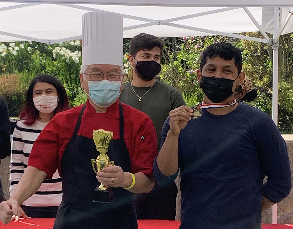Chef Yung Dae Kim and Carlos Lopez, Resident Assistant receive their awards after the competition.