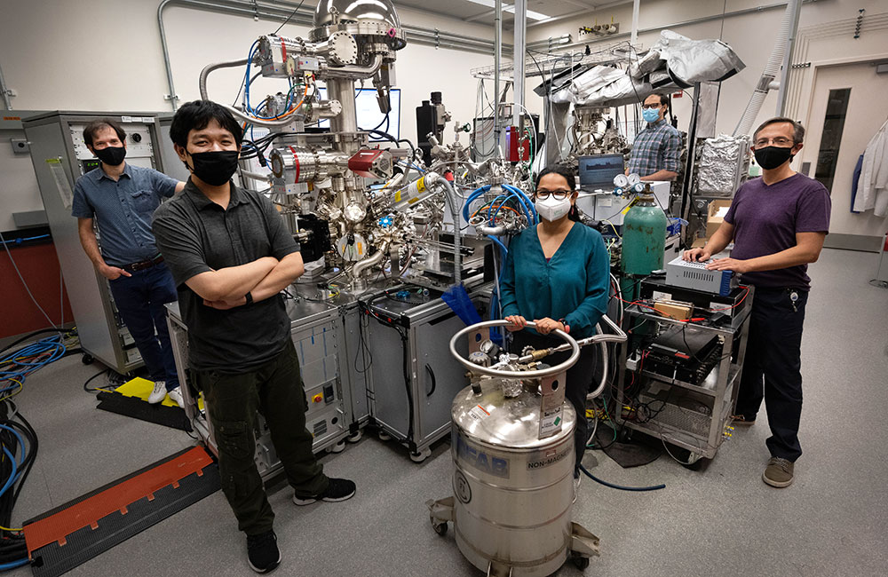 (Left to right) Anibal Boscoboinik, Yixin Xu, Shruti Sharma, Alejandro Boscoboinik and Dario Stacchiola with the ambient-pressure x-ray photoelectron spectroscopy (AP-XPS) instrument at the Center for Functional Nanomaterials. The team used this lab-based AP-XPS instrument to characterize silica (silicon and oxygen) nanocages deposited on thin films of ruthenium metal and to test treatments designed to activate the samples for noble gas trapping. Then, using the synchrotron-based AP-XPS instrument at the National Synchrotron Light Source II, they performed experiments to see whether the nanocages would effectively trap xenon. Team members not pictured: Matheus Dorneles de Mello, Chen Zhou, Burcu Karagoz, Ashley Head, Zubin Darbari, Iradwikanari Waluyo, Adrian Hunt, Sergio Manzi, and Victor Pereyra.