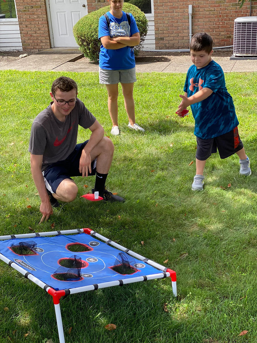 Stony Brook volunteers coordinated field day fun for families at Gigi's Playhouse.