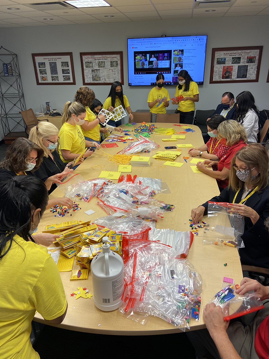 """At the """"Sending Sunshine"""" event, FSA employees and students assembled craft kits that are then sent out to patients in hospitals all over the country."""